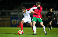Dujon Sterling (Chelsea) of England U19 holds off Ilia Djamov (Merstham) of Bulgaria U19 who is struggling to get game time at non league during the International friendly match between England U19 and Bulgaria U19 at Adams Park, High Wycombe, England on 10 October 2016. Photo by Andy Rowland.