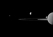 A quintet of Saturn's moons come together in the Cassini spacecraft's field of view for this portrait.  Janus (179 kilometers, or 111 miles across) is on the far left. Pandora (81 kilometers, or 50 miles across) orbits between the A ring and the thin F ring near the middle of the image. Brightly reflective Enceladus (504 kilometers, or 313 miles across) appears above the center of the image. Saturn's second largest moon, Rhea (1,528 kilometers, or 949 miles across), is bisected by the right edge of the image. The smaller moon Mimas (396 kilometers, or 246 miles across) can be seen beyond Rhea also on the right side of the image. This view looks toward the northern, sunlit side of the rings from just above the ringplane. Rhea is closest to Cassini here. The rings are beyond Rhea and Mimas. Enceladus is beyond the rings.  The image was taken in visible green light with the Cassini spacecraft narrow-angle camera on July 29, 2011. The view was acquired at a distance of approximately 1.1 million kilometers (684,000 miles) from Rhea and 1.8 million kilometers (1.1 million miles) from Enceladus. Image scale is 7 kilometers (4 miles) per pixel on Rhea and 11 kilometers (7 miles) per pixel on Enceladus..Credit: NASA-JPL-Space Science Institute via CNP