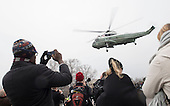 People watch as former United States President Barack Obama departs the inauguration via a helicopter, on Capitol Hill in Washington, D.C. on January 20, 2017. President-Elect Donald Trump was sworn-in as the 45th President.  <br /> Credit: Kevin Dietsch / Pool via CNP