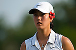 CHON BURI, THAILAND - FEBRUARY 17:  Michelle Wie of USA walks off the 18th green wearing an orchid on her ear during day one of the LPGA Thailand at Siam Country Club on February 17, 2011 in Chon Buri, Thailand. Photo by Victor Fraile / The Power of Sport Images