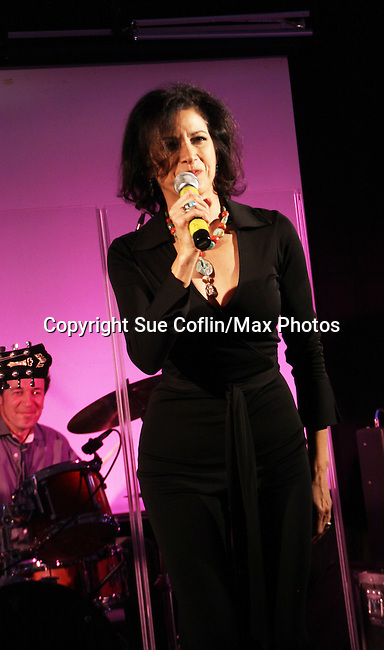 """One Life To Live's Saundra Santiago sings at the 9th Annual Rock Show for Charity to benefit the American Red Cross of Greater New York on October 9, 2010 at the American Red Cross Headquarters, New York City, New York. Also singing were Kristen Alderson (We Belong) followed by Kelley Missal, Kristen Alderson and Brittany Underwood (I Love Rock N'Roll), Brittany Underwood """"Life Is A Highway"""", Kim Zimmer """"If You Don't Know Me By Now"""" and """"Simply The Best"""", David Gregory """"I'm Gonna Be"""", Jason Tam """"Power of Love"""" and """"Jessie's Girl"""", Sandra Santiago """"Landslide"""" and """"Gloria"""". For Guiding Light - Bradley Cole """"I Ran"""", """"White Wedding"""" and ending with """"Pride and Joy"""", Karla Mosley """"I Wanna Dance"""" and """"Ben"""". Items were auctioned off and many dollars were raised. (Photos by Sue Coflin/Max Photos)"""