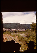 Dolores River Canyon taken out the rear door of southbound RGS Goose #4.  Red Rock is in the distance.<br /> RGS  Stoner (s. of), CO  Taken by Maxwell, John W. - 7/13/1946