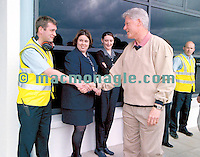 Bill Clinton pictured upon arrival at Kerry Airport on Sunday morning and is greeted by Kerry Airport worker John Sheehan.<br />