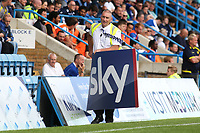 A Gillingham steward removes a Sky advertising board after it was blown by the wind to the side of the pitch  during Gillingham vs Burton Albion, Sky Bet EFL League 1 Football at The Medway Priestfield Stadium on 10th August 2019
