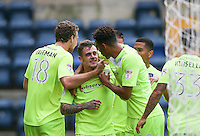 Sammie Szmodics (centre) of Colchester United celebrates his goal during the Sky Bet League 2 match between Wycombe Wanderers and Colchester United at Adams Park, High Wycombe, England on 27 August 2016. Photo by Andy Rowland.