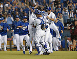 Royals team group,<br /> OCTOBER 5, 2014 - MLB :<br /> Salvador Perez of the Kansas City Royals celebrates with his teammates including Norichika Aoki (R) after winning the American League Division Series (ALDS) Game 3 against the Los Angeles Angels at Kauffman Stadium in Kansas City, Missouri, United States. (Photo by AFLO)