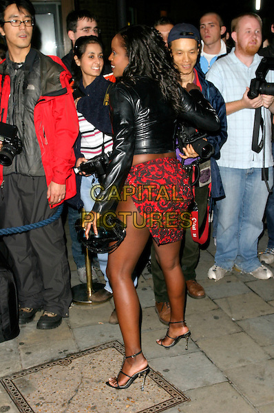 """KELLE BRYAN.Arriving to watch """"Chicago"""" at the Cambridge Theatre,.London, England, September 25th 2006..full length black leather jacket tummy midriff red pattrened mini short skirt back rear behind kelly.Ref: AH.www.capitalpictures.com.sales@capitalpictures.com.©Adam Houghton/Capital Pictures."""