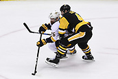 8th June 2017, Pittsburgh, PA, USA; Nashville Predators right wing Harry Zolnierczyk (26) skates with the puck as Pittsburgh Penguins defenseman Justin Schultz (4) defends during the third period. Game Five was won 6-0 by the Pittsburgh Penguins against the Nashville Predators during the 2017 NHL Stanley Cup Final on June 8, 2017, at PPG Paints Arena in Pittsburgh, PA. The Penguins take a 3-2 series lead in the best of seven series with the victory.