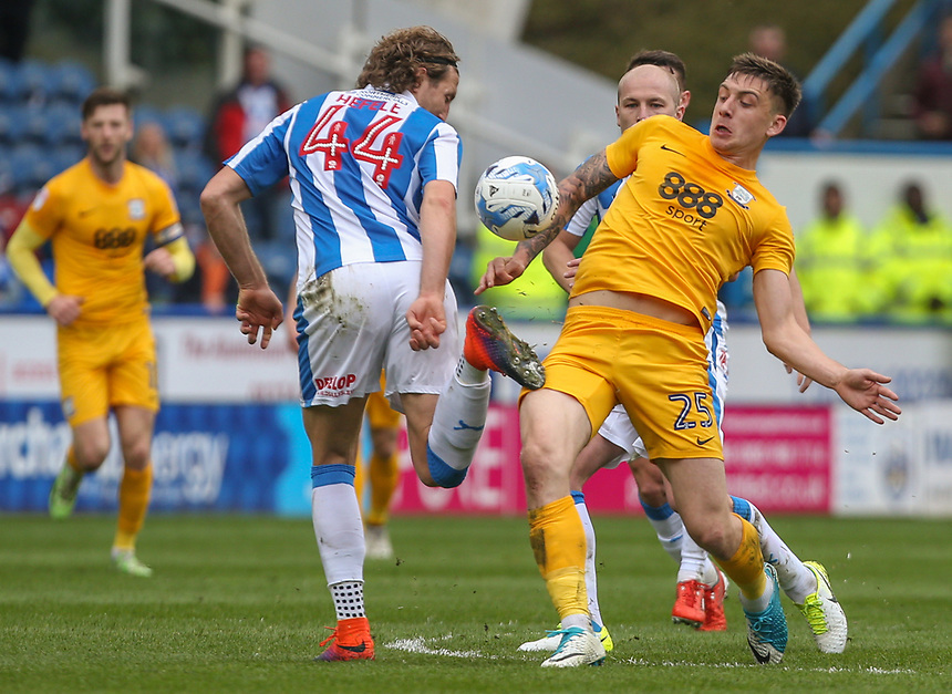 Preston North End's Jordan Hugill battles with Huddersfield Town's Michael Hefele<br /> <br /> Photographer Alex Dodd/CameraSport<br /> <br /> The EFL Sky Bet Championship - Huddersfield Town v Preston North End - Friday 14th April 2016 - The John Smith's Stadium - Huddersfield<br /> <br /> World Copyright &copy; 2017 CameraSport. All rights reserved. 43 Linden Ave. Countesthorpe. Leicester. England. LE8 5PG - Tel: +44 (0) 116 277 4147 - admin@camerasport.com - www.camerasport.com