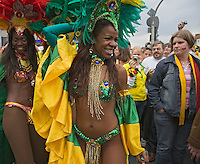 Germany, DEU, Dortmund, 2006-Jun-22: FIFA football world cup (USA: soccer world cup) 2006 in Germany; a Brazilian samba group dancing in the street, watched by German football fans on their way to the world cup stadium.