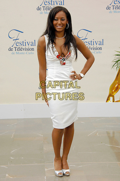 "MEL B.Photocall promoting the television series ""Dancing with the Stars"" during the 2008 Monte Carlo Television Festival held at Grimaldi Forum, Monaco, Principality of Monaco..June 12th, 2008.melanie brown scary full length white dress low cut plunging neckline cleavage beads beaded trim silver shoes hand on hip.CAP/TTL .© TTL/Capital Pictures"