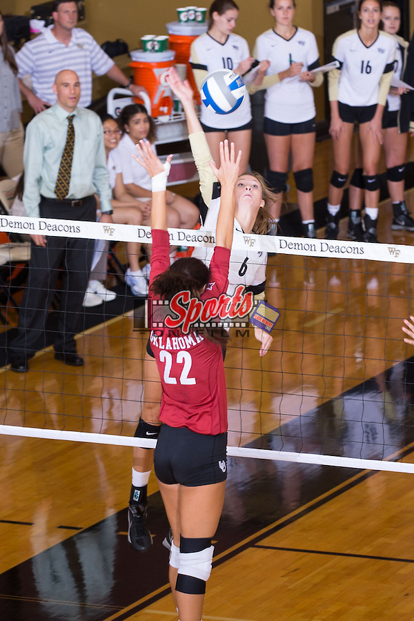 Matalee Reed (6) of the Wake Forest Demon Deacons attacks the ball during the match against the Oklahoma Sooners in Reynolds Gymnasium on September 18, 2014 in Winston-Salem, North Carolina.  The Sooners defeated the Demon Deacons 3-0.   (Brian Westerholt/Sports On Film)