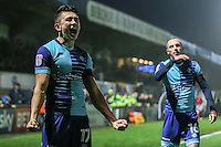 Luke O'Nien of Wycombe Wanderers (left) celebrates after he scores his team's second goal of the game to make it 2-0 during the Sky Bet League 2 match between Wycombe Wanderers and Morecambe at Adams Park, High Wycombe, England on 12 November 2016. Photo by David Horn.