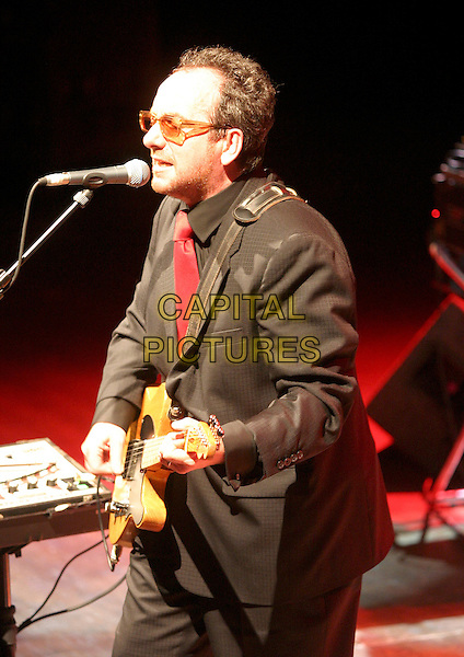 ELVIS COSTELLO.Performs live in concert at the Royal Centre in Nottingham, May 26th 2005..half length gig guitar glasses suit .Ref: JEZ.www.capitalpictures.com.sales@capitalpictures.com.©Jez Self/Capital Pictures