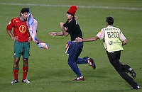 A fan runs on the pitch and throws a Barcelona flag at Luis Figo during the UEFA Euro 2004, Final match between Portugal and Greece at the Luz Stadium on July 4, 2004 in Lisbon, Portugal. Greece defeated Portugal 1-0.