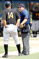 July 13, 2009:  Home plate umpire Ramon Hernandez explains his ruling to GCL Pirates manager Tom Prince after not allowing a batter to go to first base after being hit by a pitch during a game at Tiger Town in Lakeland, FL.  The batter was ruled to have stuck his elbow into the pitch.  Photo By Mike Janes/Four Seam Images