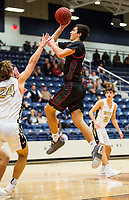 Springdale Bulldogs vs Bentonville West Woverines Basketball - Carl Fitch of Springdale shoots the ball, as Ben Larsen of Bentonville West defends at Wolverine Arena, Bentonville, AR on February 9, 2018.   Special to NWA Democrat-Gazette/ David Beach