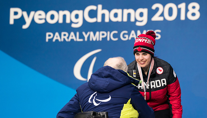 PyeongChang 11/3/2018 - Alana Ramsay collects her bronze medal in the women's standing super-G during the medal ceremony at the PyeongChang Olympic Plaza during the 2018 Winter Paralympic Games in Pyeongchang, Korea. Photo: Dave Holland/Canadian Paralympic Committee