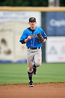 Akron RubberDucks center fielder Andrew Calica (15) jogs back to the dugout during a game against the Harrisburg Senators on August 18, 2018 at FNB Field in Harrisburg, Pennsylvania.  Akron defeated Harrisburg 5-1.  (Mike Janes/Four Seam Images)