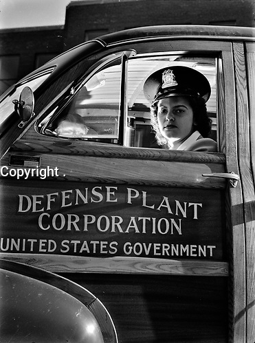 To replace men who have been called to armed service, many young girls like 19-year-old Jewel Halliday are taking jobs never before held by women. October 1943.<br /> <br /> Photo by Arthur S. Siegel.
