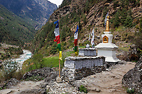 Mani Stones in the Dudh Kosi River Valley on the trail to Everest Base Camp in the Himalayan Mountains of Nepal.