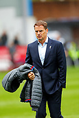 10th September 2017, Turf Moor, Burnley, England; EPL Premier League football, Burnley versus Crystal Palace; Crystal Palace Manager Frank de Boer carries his coat conscious that his job may be on the line tomorrow morning if the result does not go his way today
