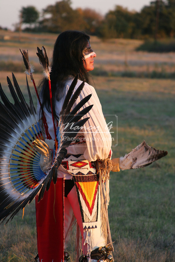 An Apache Native American Indian at sunset
