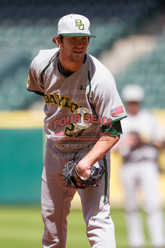 Baylor Bears pitcher Drew Tolson (27) looks to his catcher for the sign during Houston College Classic against the Hawaii Rainbow Warriors on March 6, 2015 at Minute Maid Park in Houston, Texas. Hawaii defeated Baylor 2-1. (Andrew Woolley/Four Seam Images)