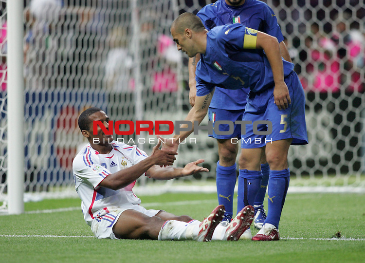 FIFA WM 2006 - Final / Finale<br /> Play #64 (09-Jul) - Italy vs France.<br /> Fabio Cannavaro (r) from Italy and Jean-Alain Boumsong (l) from France during the match of the World Cup in Berlin.<br /> Foto &copy; nordphoto