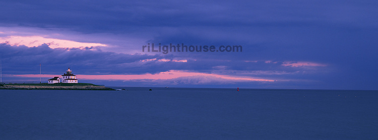 An approaching storm front casts a purple shadow in this panoramic image of Watch Hill Lighthouse.