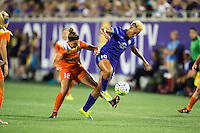 Orlando, Florida - Saturday, April 23, 2016: Orlando Pride forward Lianne Sanderson (10) battles Houston Dash midfielder Amber Brooks (12) for the ball during an NWSL match between Orlando Pride and Houston Dash at the Orlando Citrus Bowl.