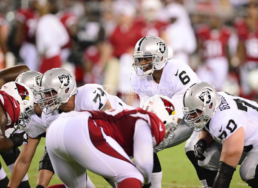 Aug. 17, 2012; Glendale, AZ, USA; Oakland Raiders quarterback (6) Terrelle Pryor against the Arizona Cardinals during a preseason game at University of Phoenix Stadium. The Cardinals defeated the Raiders 31-27. Mandatory Credit: Mark J. Rebilas-