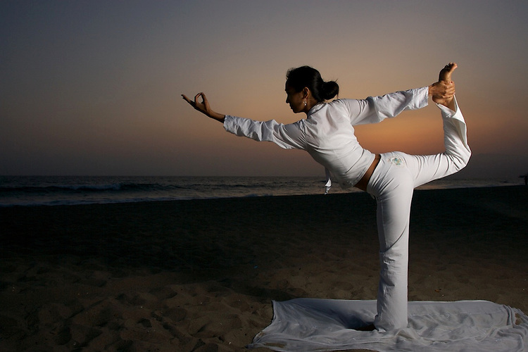 Pure (Para) Yoga Asanas in the beach at sunset.