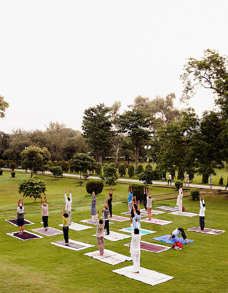 A group of Indians practice early morning yoga asanas in Lodi Gardens, New Delhi, India.
