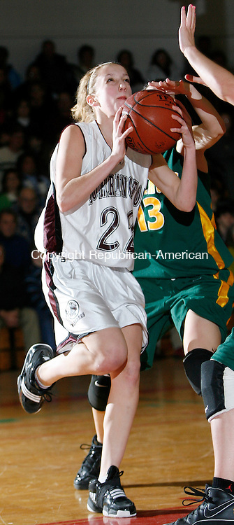 Torrington, CT-011309MK01 Torrington's #22 Lauren Cilfone drives to the basket Holy Cross' #13 Julia Shea during NVL action at Torrington High School Tuesday night.  Torrington defeated Holy Cross 63 - 49 . Michael Kabelka / Republican-American
