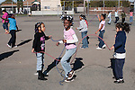 Oakland Ca 2nd grade girls playing jump rope at recess