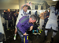Pictured: Coach Gary Richards gets drenched in champagne by Oliver McBurnie and other players Monday 15 May 2017<br />