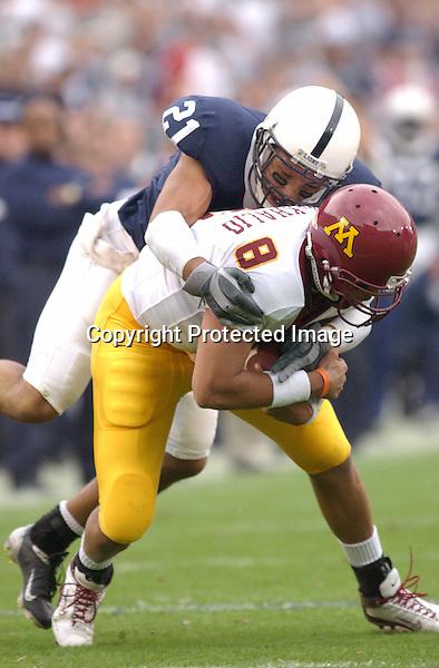27 September 2003:  Alan Zemaitis (21) tackles Minnesota QB Asad Abdul-Khaliq(8).  Minnesota defeated Penn State 20-14  at Beaver Stadium in State College, PA....