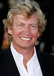 "Producer Nigel Lythgoe arrives at the Los Angeles Premiere Of ""Tropic Thunder"" at the Mann's Village Theater on August 11, 2008 in Los Angeles, California."