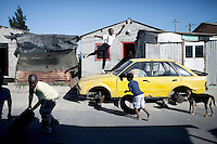 CAPE TOWN, SOUTH AFRICA - MARCH 23: Sikhumbuzo Hlahleni, age 15, a student at Cape Town City Ballet's youth company poses for pictures outside his family house on March 23, 2010 in Khayelitsha, South Africa. He trains in Cape Town every Saturday. He also trains a few days week at home in Khayelitsha, a poor township outside Cape Town. He has to change taxi three times to get to the school. (Photo by Per-Anders Pettersson)