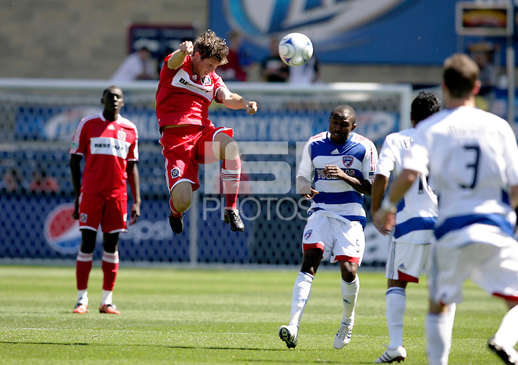Chicago Fire midfielder Logan Pause (7) goes high for a header.  FC Dallas defeated the Chicago Fire 3-0 at Toyota Park in Bridgeview, IL on May 31, 2009.