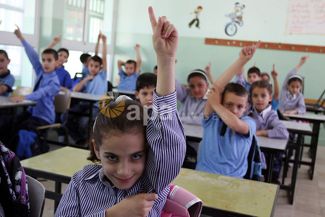 Palestinian students return back to their school in the morning of the first day of the new year study in the West Bank city of Ramallah on Sep. 4, 2011. Photo by Issam Rimawi