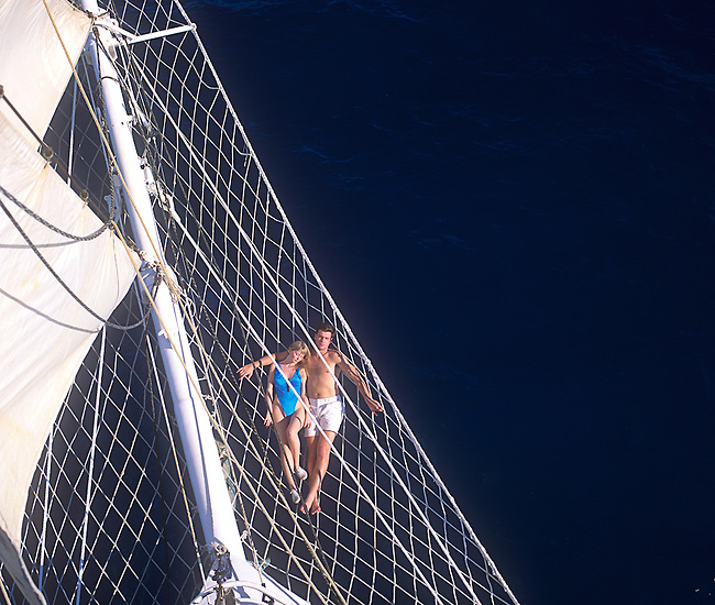 Aerial, Couple Relaxing on Sailboat<br /> Model(s) Released