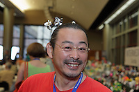 Hajime Komiya with his origami windmills