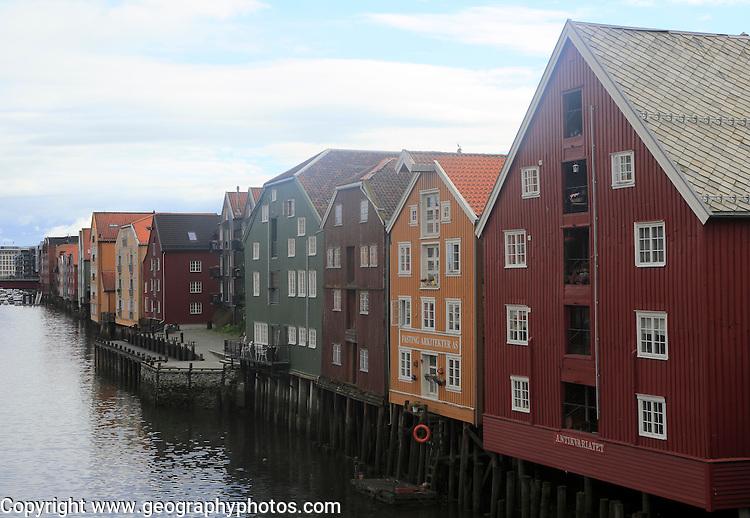 Historic waterside warehouse buildings on River Nidelva, Bryggene, Trondheim, Norway