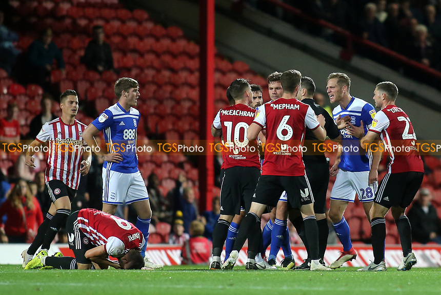 Tempers flare in the second half as Brentford's Neal Maupay remains on the ground clutching his face during Brentford vs Birmingham City, Sky Bet EFL Championship Football at Griffin Park on 2nd October 2018