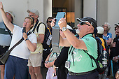 A tourist uses an iPad to take a photograph, Vienna.