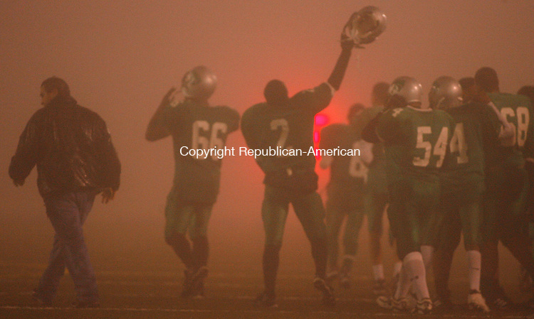 Waterbury, CT-21 November2007-112107MK07 Heavy Fog envelopes Wilby's Captin #2 Derrick Collins as Wiilby celebrates their victory over Sacred Heart in  their final game of the season during NVL action against Scared Heart Wednesday night. The Wild Cats defeated the Hearts  33-21 .  Michael Kabelka / Republican-American  (Wilby's Captin #2 Derrick Collins  )CQ