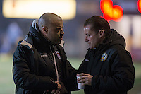 Grimsby manager Marcus Bignot greets Newport County manager Graham Westley during the Sky Bet League 2 match between Newport County and Grimsby Town at Rodney Parade, Newport, Wales on 14 February 2017. Photo by Mark  Hawkins / PRiME Media Images.
