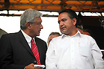 Leftist leader Andres Manuel Lopez Obrador (L) talks with the secretary-general of the Electrical Workers Union Martin Espaza during a rally against the dissolution of the Luz y Fuerza del Centro (LFC) company in front of the Mexican Congress, October 12, 2009. More than sixty thousand workers demand the Calderon's action as illegal and unconstitutional. The Electrical Workers Union (SME) is an union since 1914 and it has leading historic workers struggles in Mexico. Photo by Heriberto Rodriguez